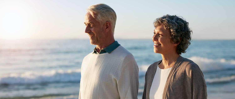 Happy-Senior-Couple-Walking-on-the-Beach-SAN RAMON VALLEY FAMILY MEDICINE
